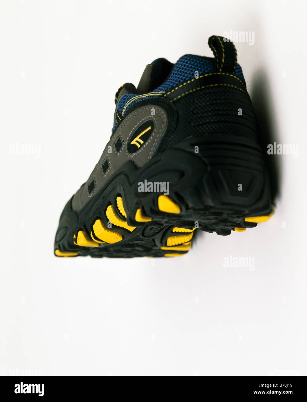 black trainers with yellow soles Stock