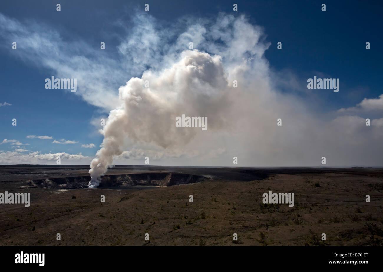 Smoke and gas pouring from Halema'uma'u caldera, Kilauea volcano, Big Island, Hawaii - Stock Image