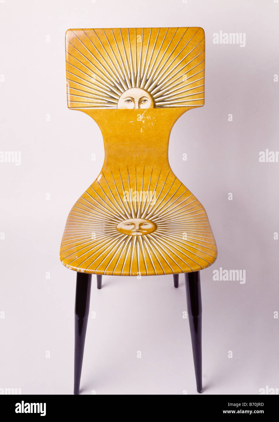 Close-up of yellow Fornasetti sunburst chair - Stock Image