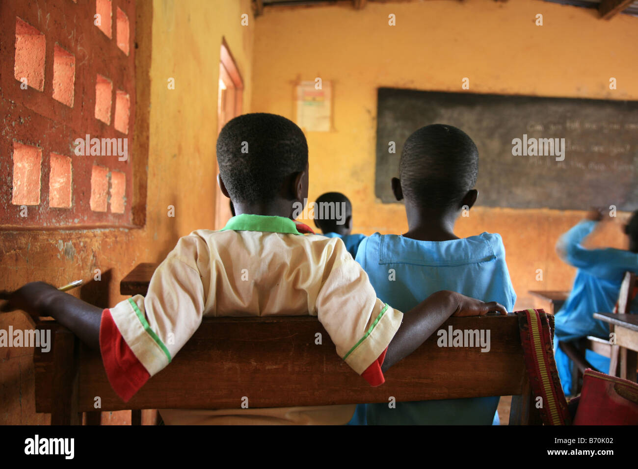 Two boys from the Islamic school in Sunyani Ghana listening to the teacher In Ghana coranic schools were transformed - Stock Image