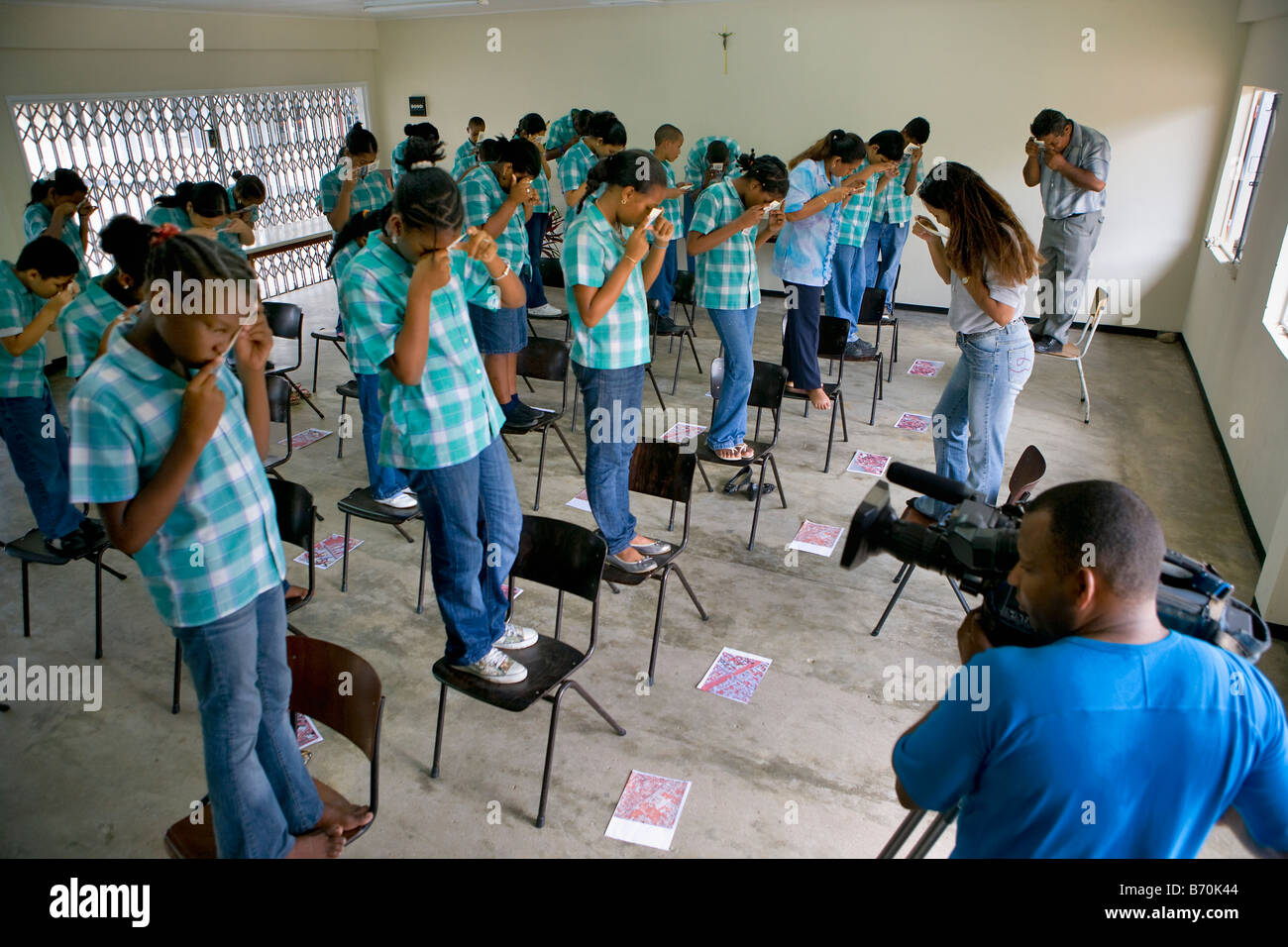 Suriname, Paramaribo, Cartography, Children learning at school about aerial photography. - Stock Image