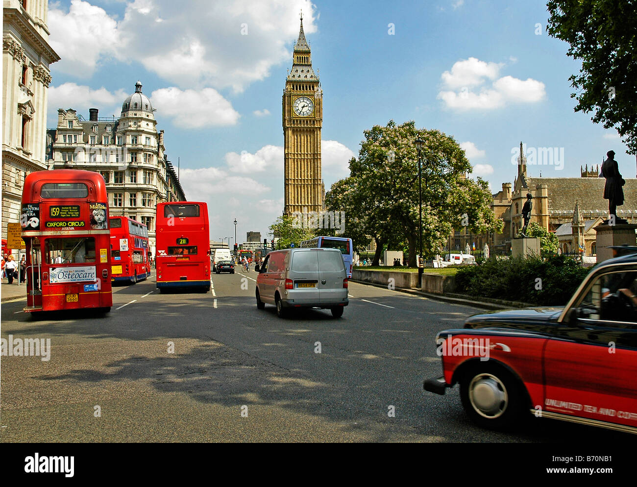 Red Double decker buses and cars in front of Big Ben London UK - Stock Image
