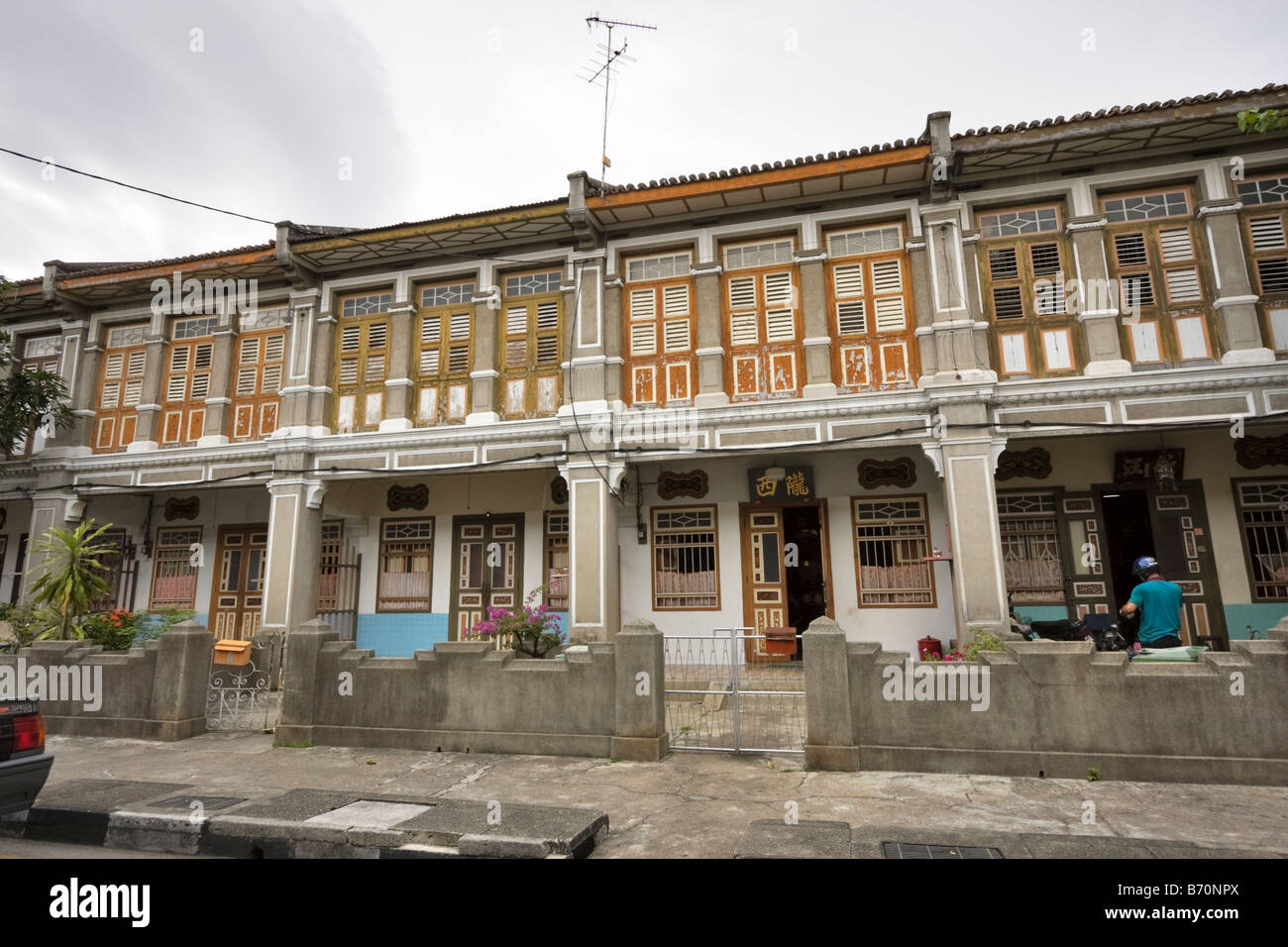Old shophouses in need of restoration in Georgetown, Penang, Malaysia - Stock Image