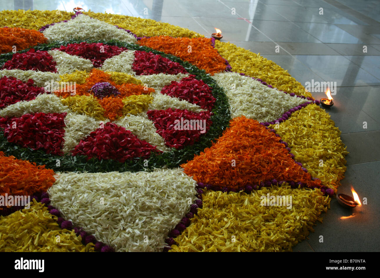 Beautiful floral decoration with lamps during popular Kerala festival Onam which marks the return of King Maveli - Stock Image