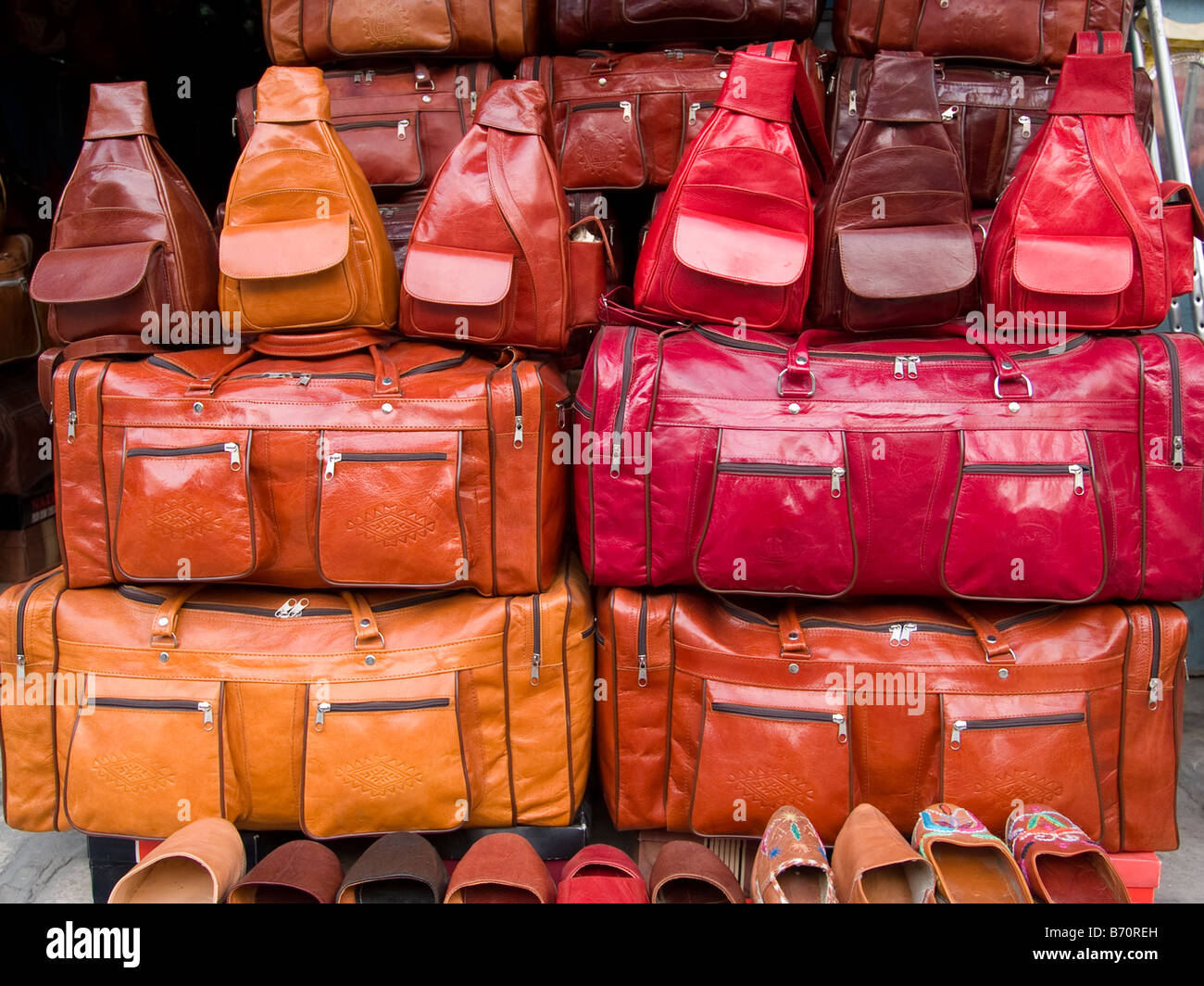leather goods for sale in a Tunisian souk - Stock Image