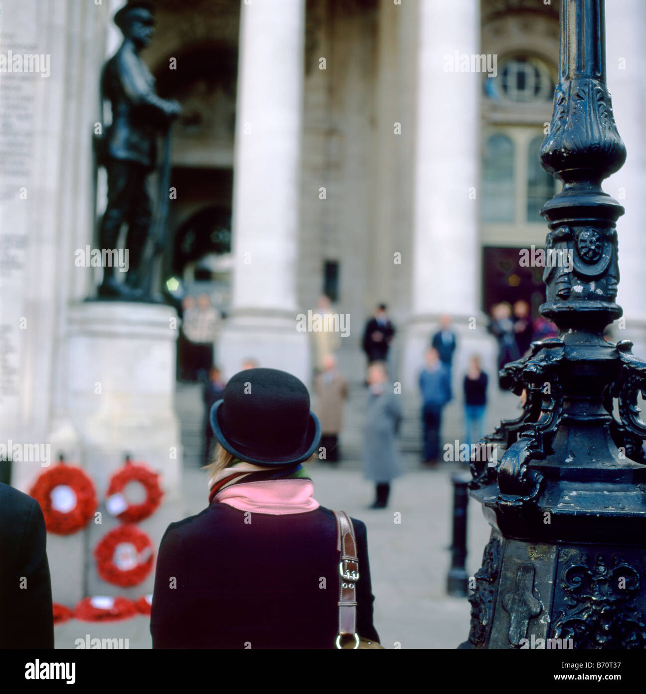 A woman in a bowler hat at the Royal Exchange Armistice Day Remembrance Day WWI and WWII memorial celebration in - Stock Image