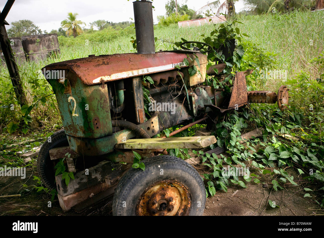 Suriname, Paramaribo, Restored plantation called Frederiksdorp at the Commewijne river. Old tractor. - Stock Image
