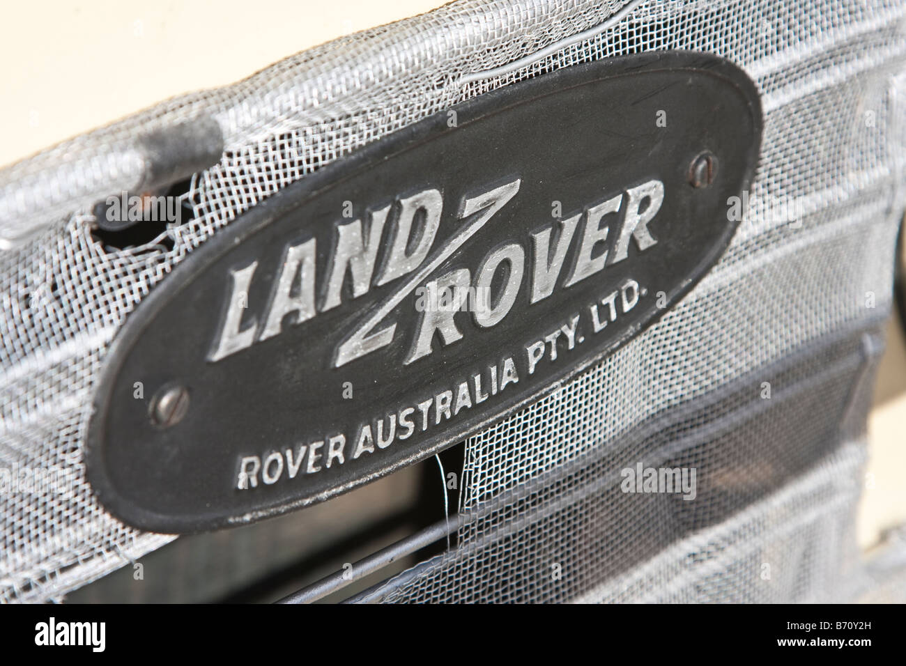 Land Rover Australia Pty Ltd badge on nose of Land Rover Six - Stock Image