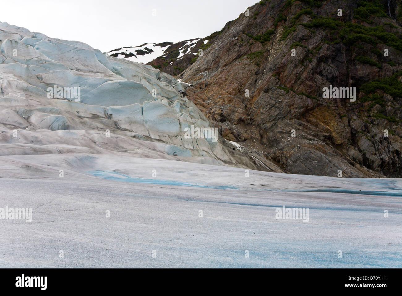 Mendenhall Glacier presses against mountains of rock near Juneau, Alaska - Stock Image