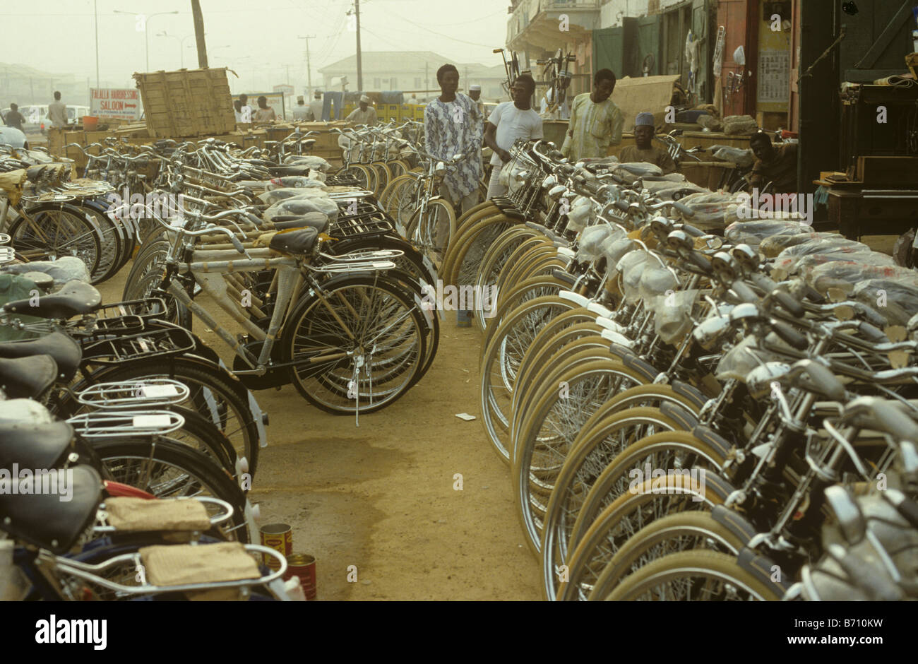 Bicycle sales on a street in Kano Nigeria during the dust storm caused by the hamatan 1980s - Stock Image