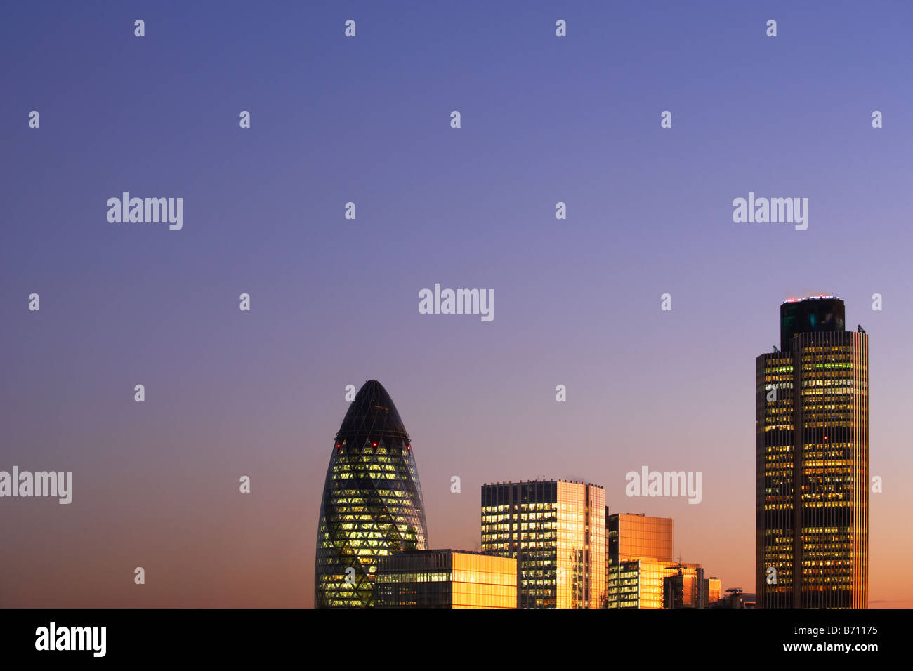 Nat West Tower Gherkin and London skyline at sunset London England - Stock Image