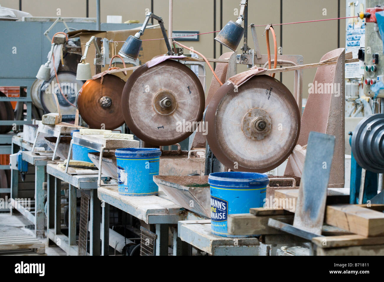 Idle Cutting Stations: A row of idle cutting stations at the Waterford Crystal Factory - Stock Image