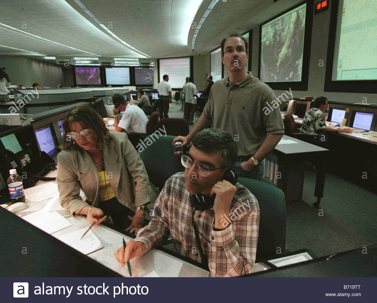 5 11 01 FAA COMMAND CENTER Stephanie Runyon and Joe Hof of the severe weather unit both seated and Steve McMahon - Stock Image
