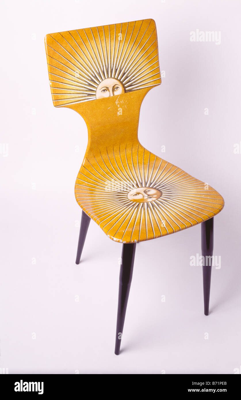 Close-up of yellow Fornasetti chair - Stock Image