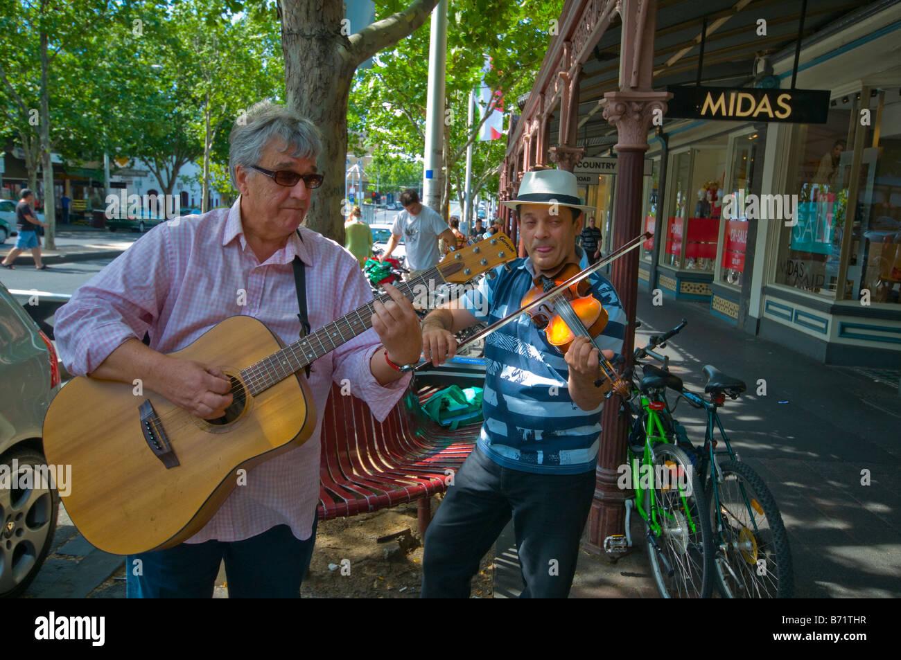Buskers in Lygon Street Carlton Melbourne Australia - Stock Image