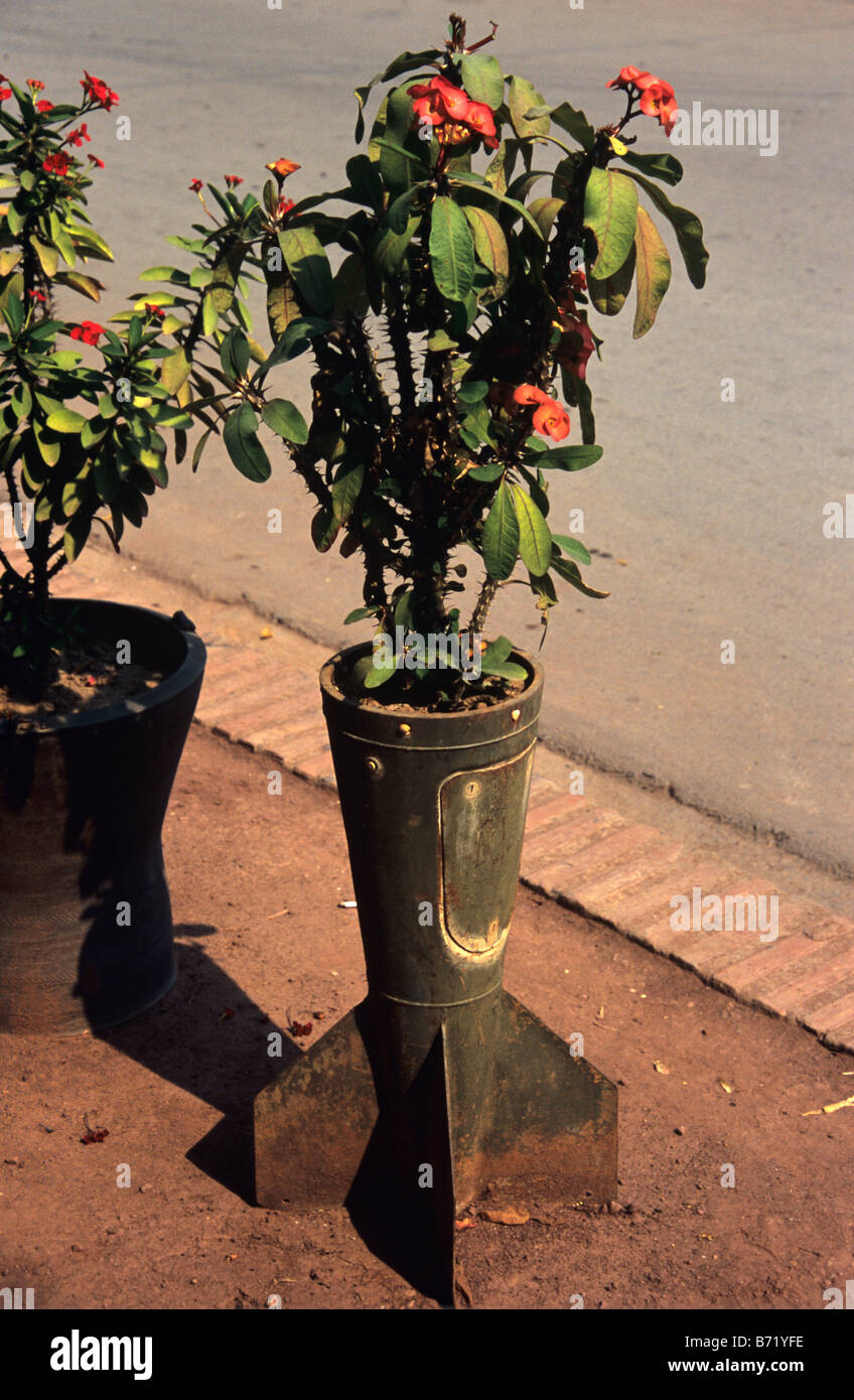The tail fin of a Vietnam War-era US Cluster Bomb or Missile used as a Planter in the streets of Luang Prabang, Stock Photo