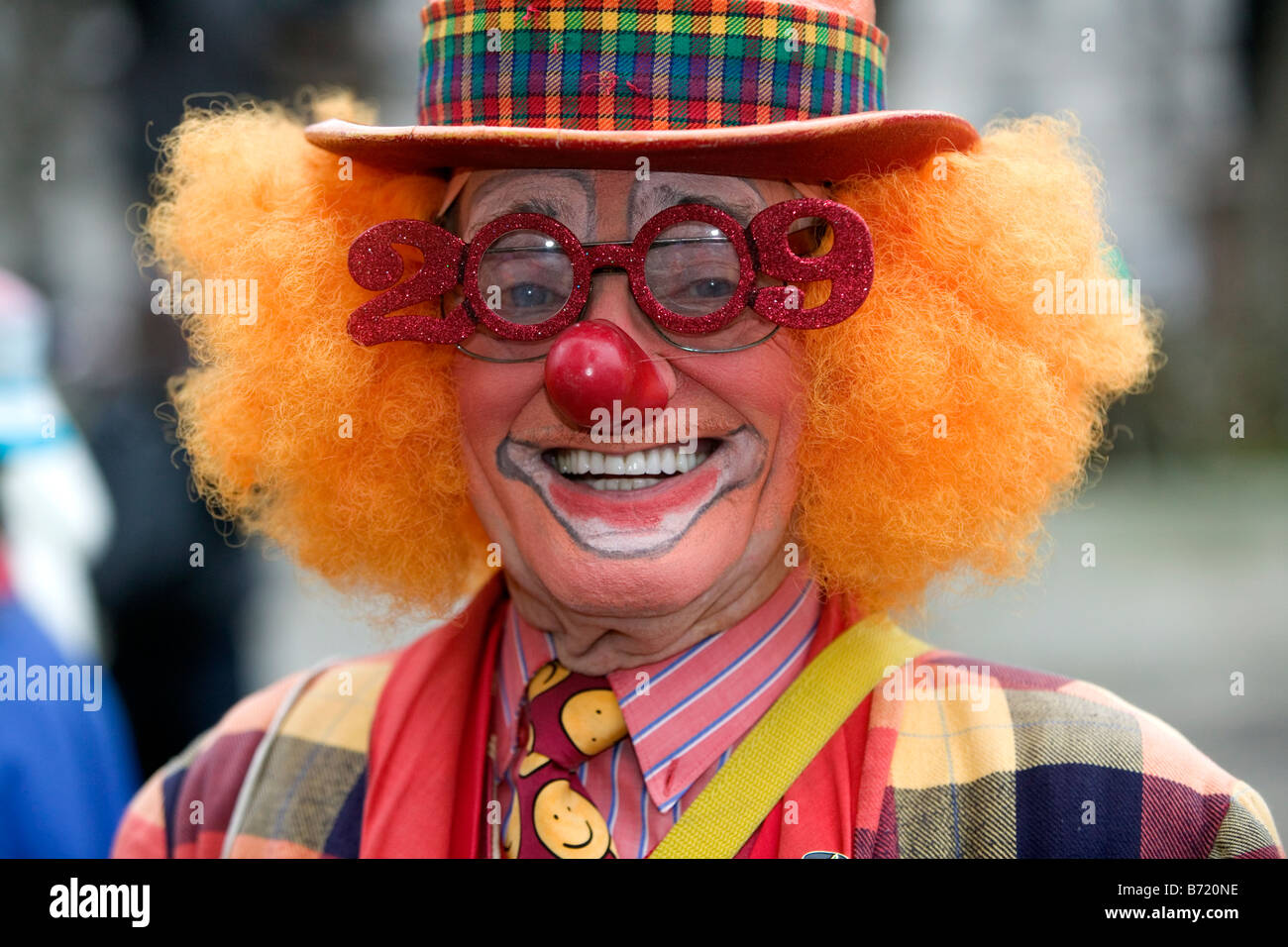 Colourful clown with '2009' glasses at the London Parade, a New Year's Day Parade in Central London - Stock Image