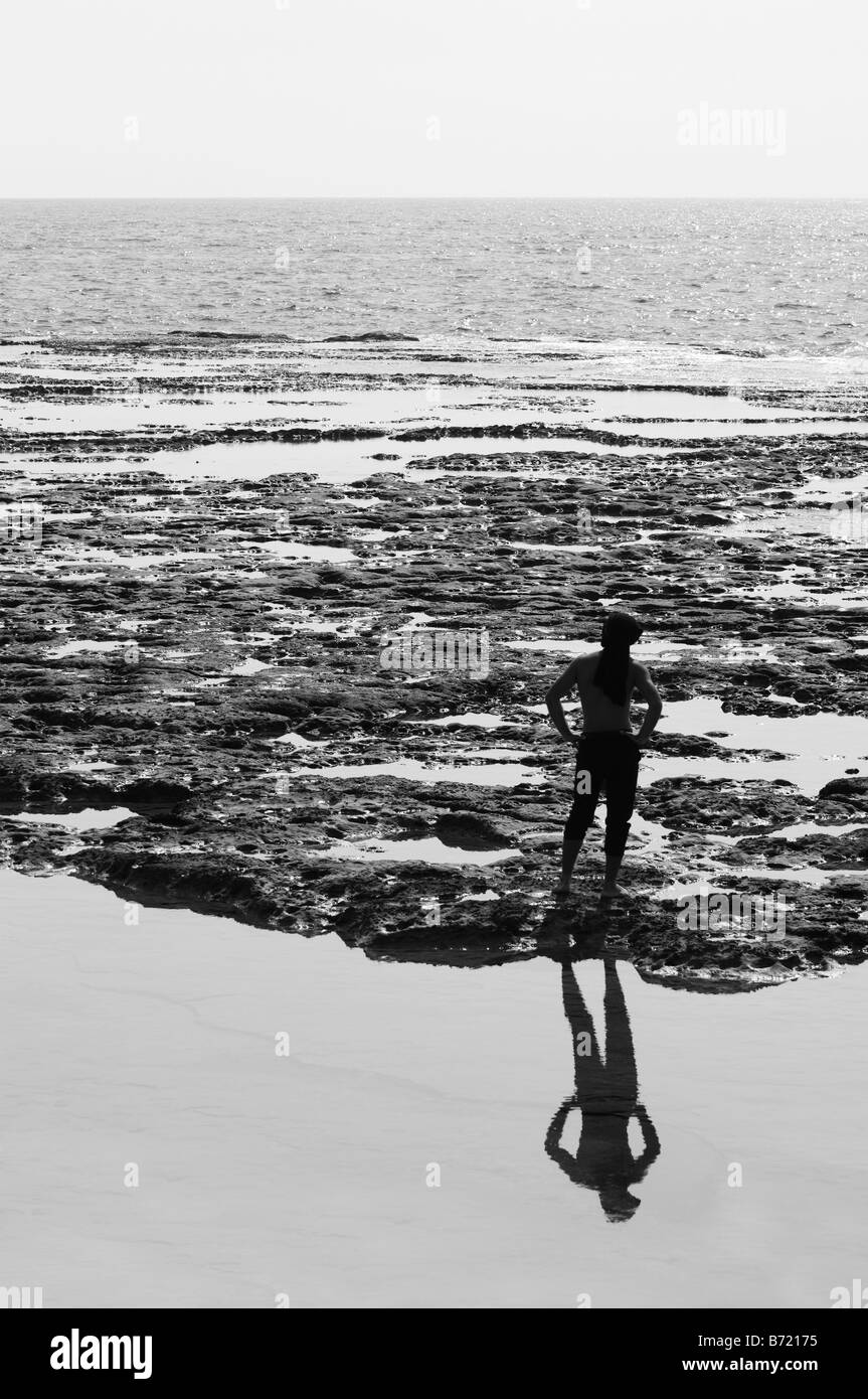 Man contemplating by the sea - Stock Image