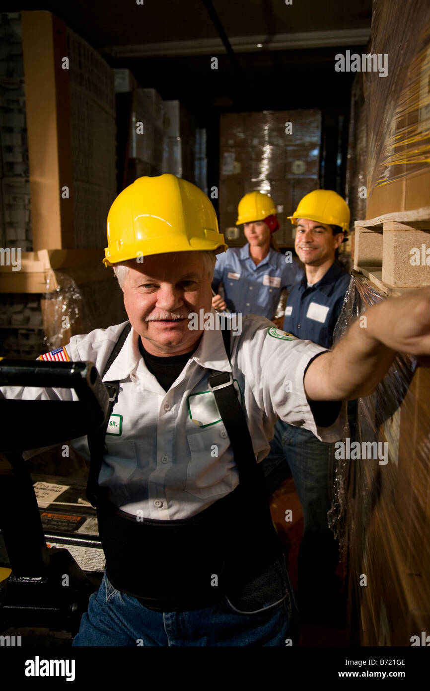 Three co-workers in storage warehouse Stock Photo