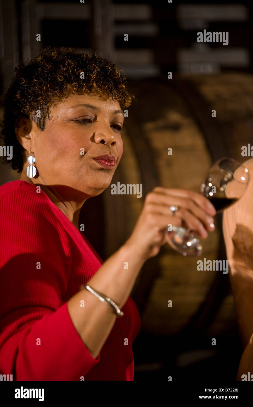 African American woman examining wine color on a winery tour - Stock Image  sc 1 st  Alamy & African American Wine Cellar Stock Photos u0026 African American Wine ...