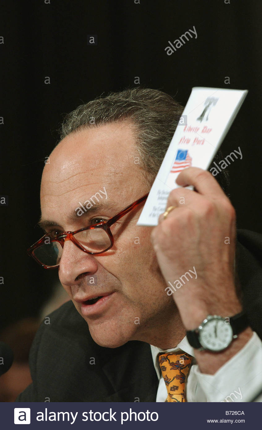 5 6 03 JUDICIAL FILIBUSTERS Sen Charles E Schumer D N Y holds up a copy of the U S Constitution as he testifies - Stock Image