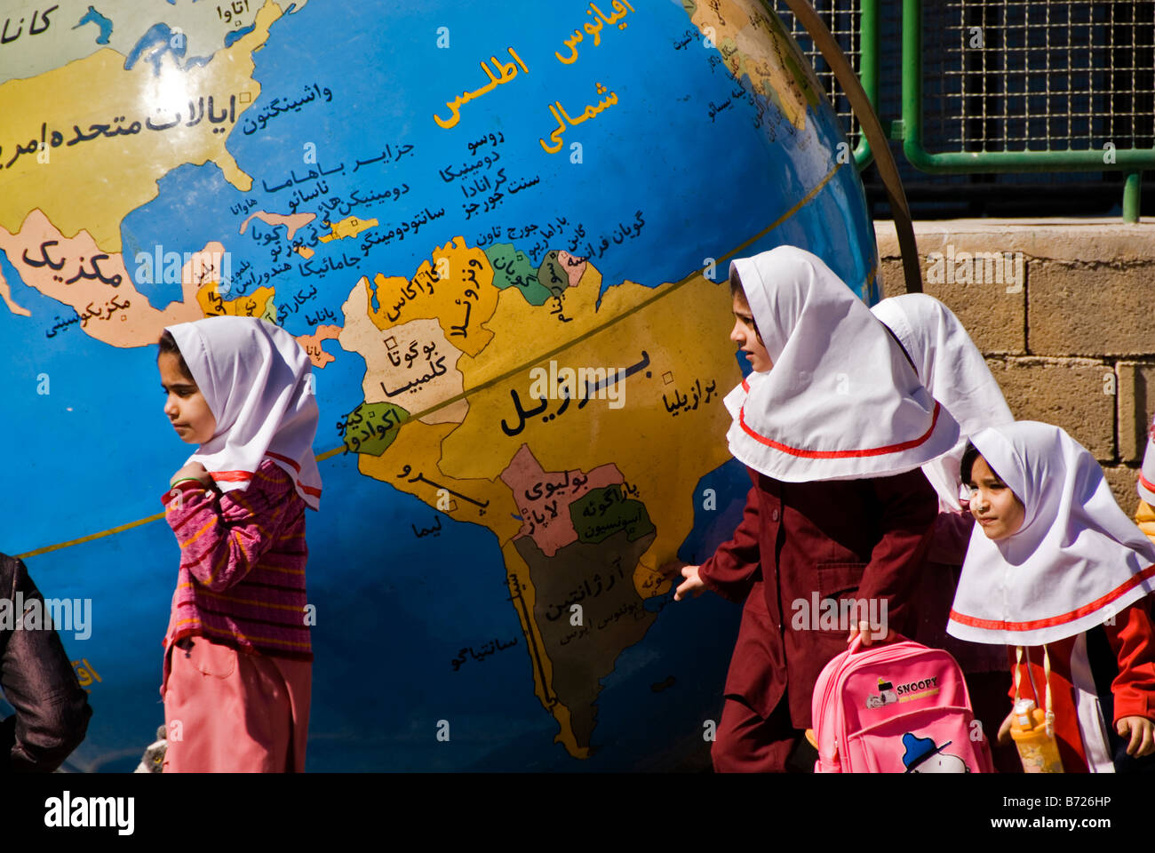 Schoolgirls in front of a map of the world Isfahan Iran - Stock Image