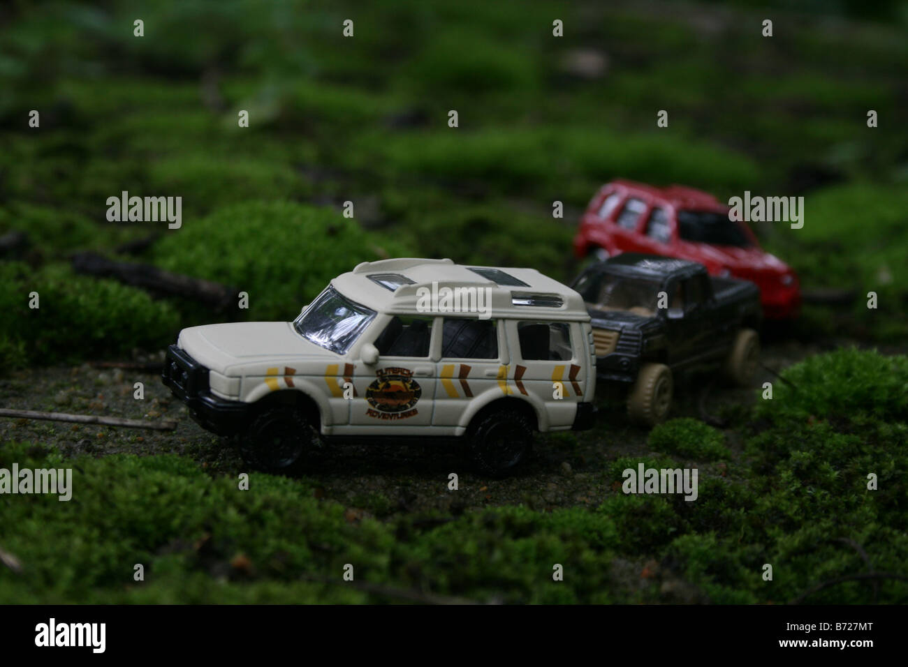 Toy car jeep suv safari Tourists in SUV and pick-up cabs touring the lush green tea estates during their annual - Stock Image