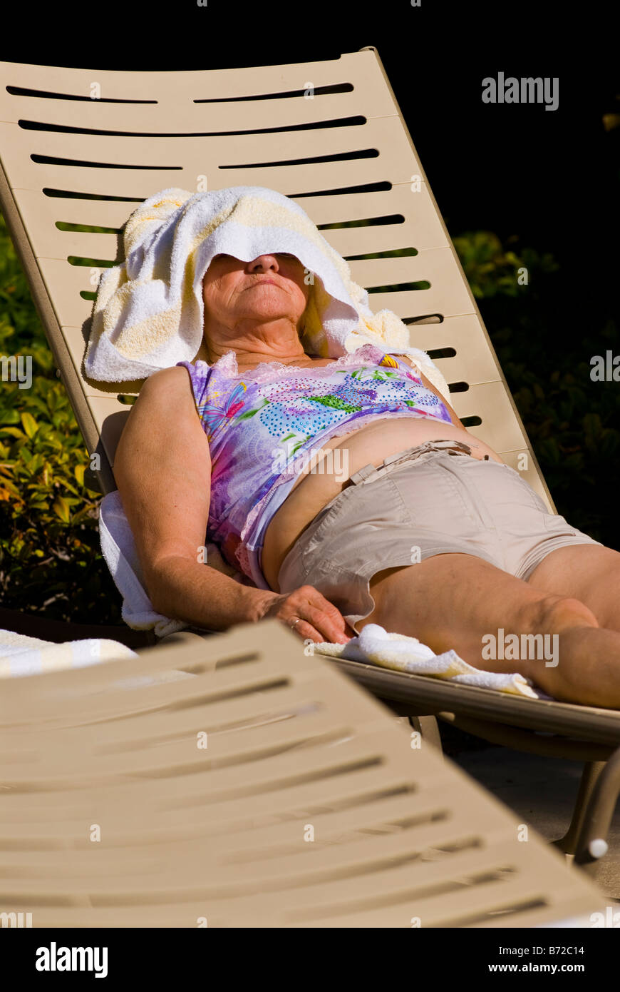 fat lady on beach in stock photos & fat lady on beach in stock