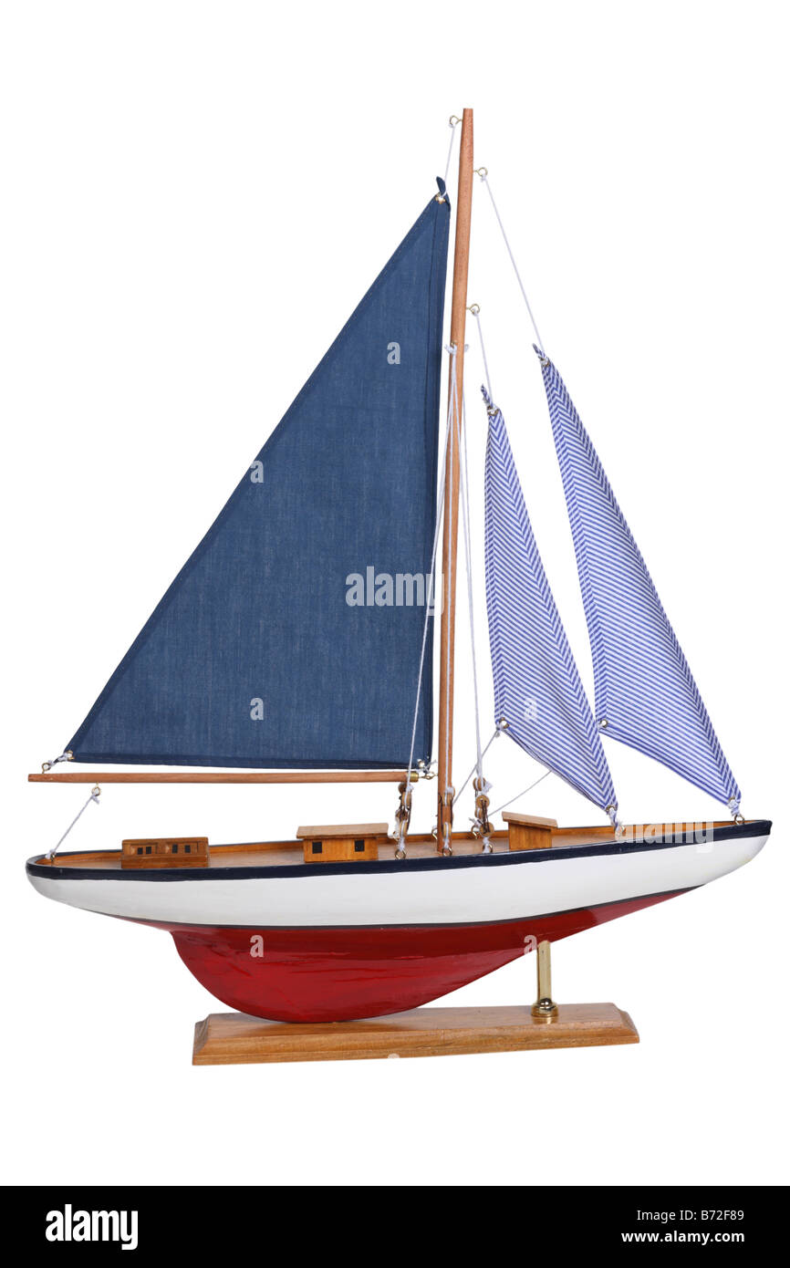 Yacht sail boat model cut out on white background - Stock Image