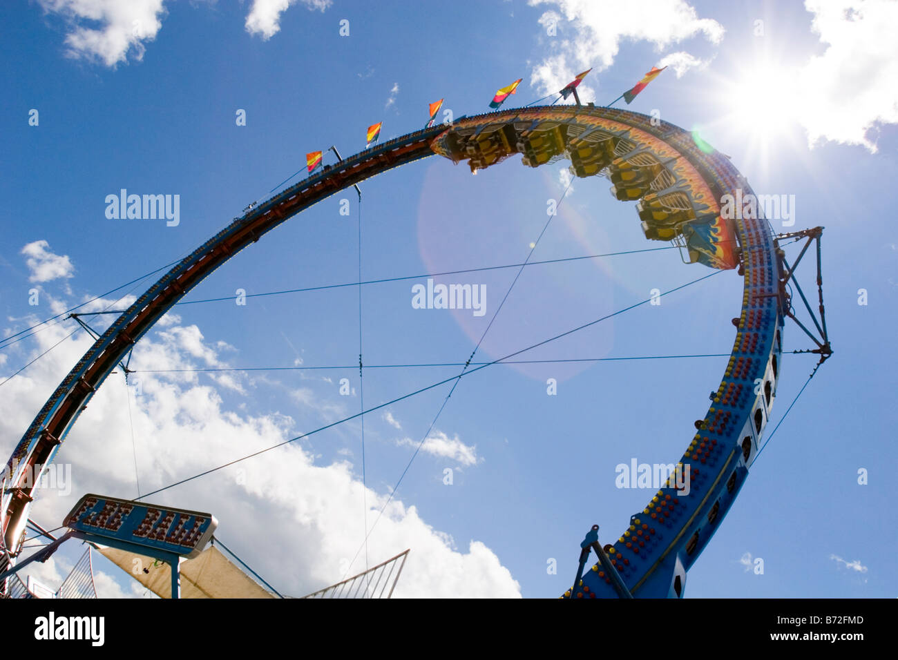 Upside down ride at amusement park in a county fair. - Stock Image