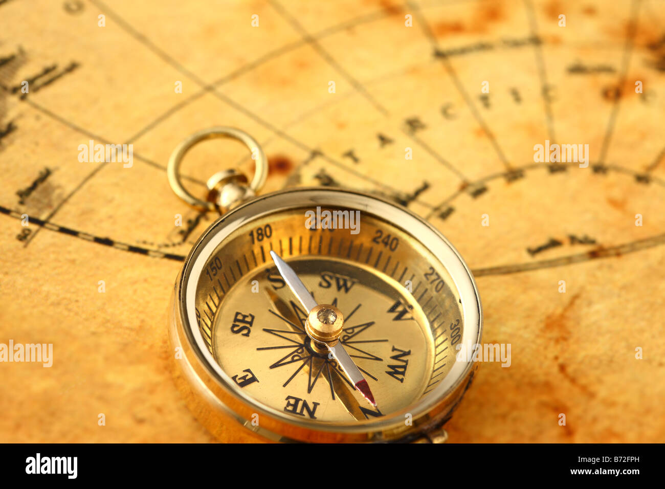 Antique golden compass and old map - Stock Image