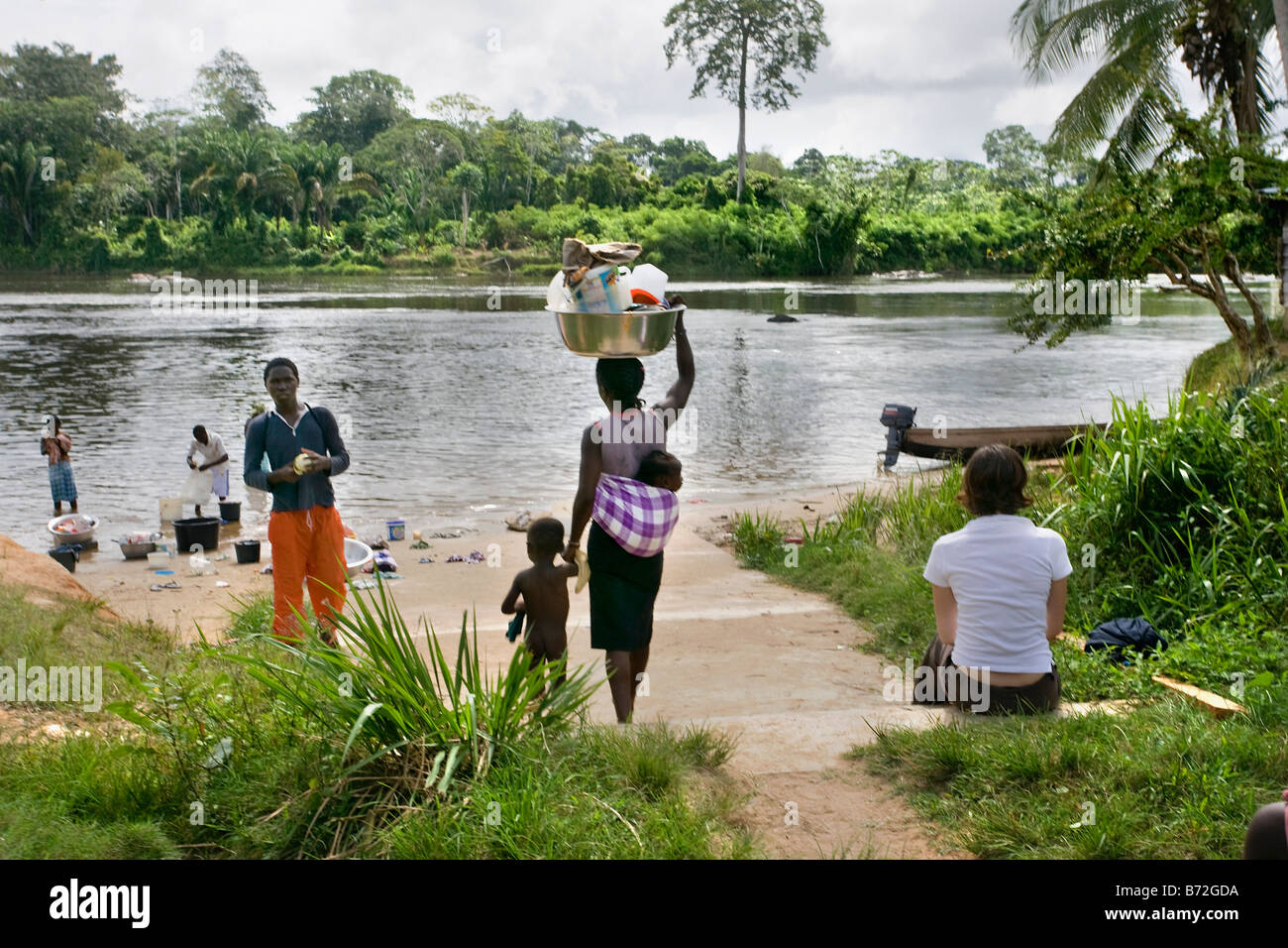Suriname, Laduani, at the bank of the Boven Suriname river. People from Saramaccaner tribe at river bank. Tourist. - Stock Image