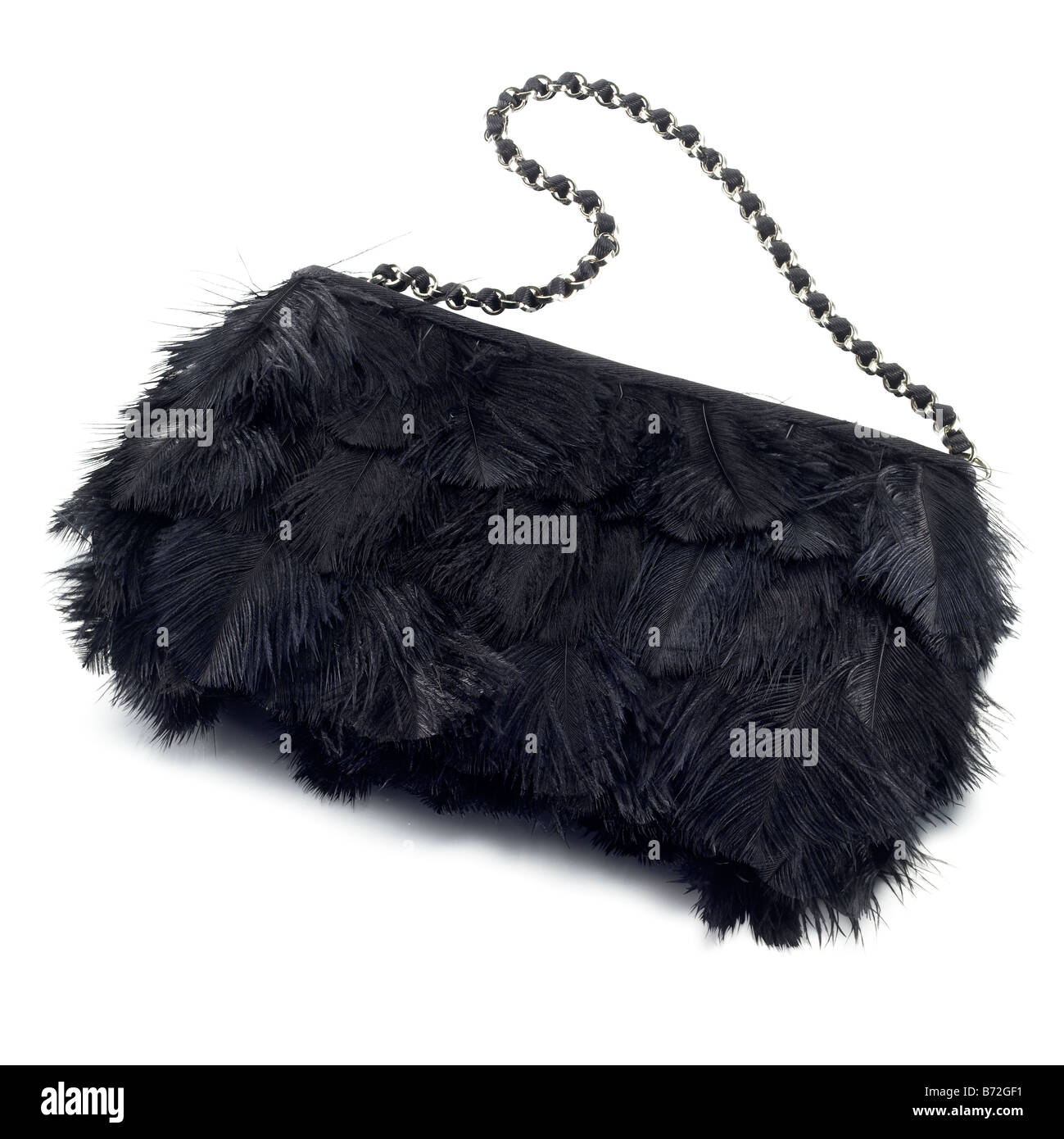 black feather covered ladies bag clutch purse - Stock Image
