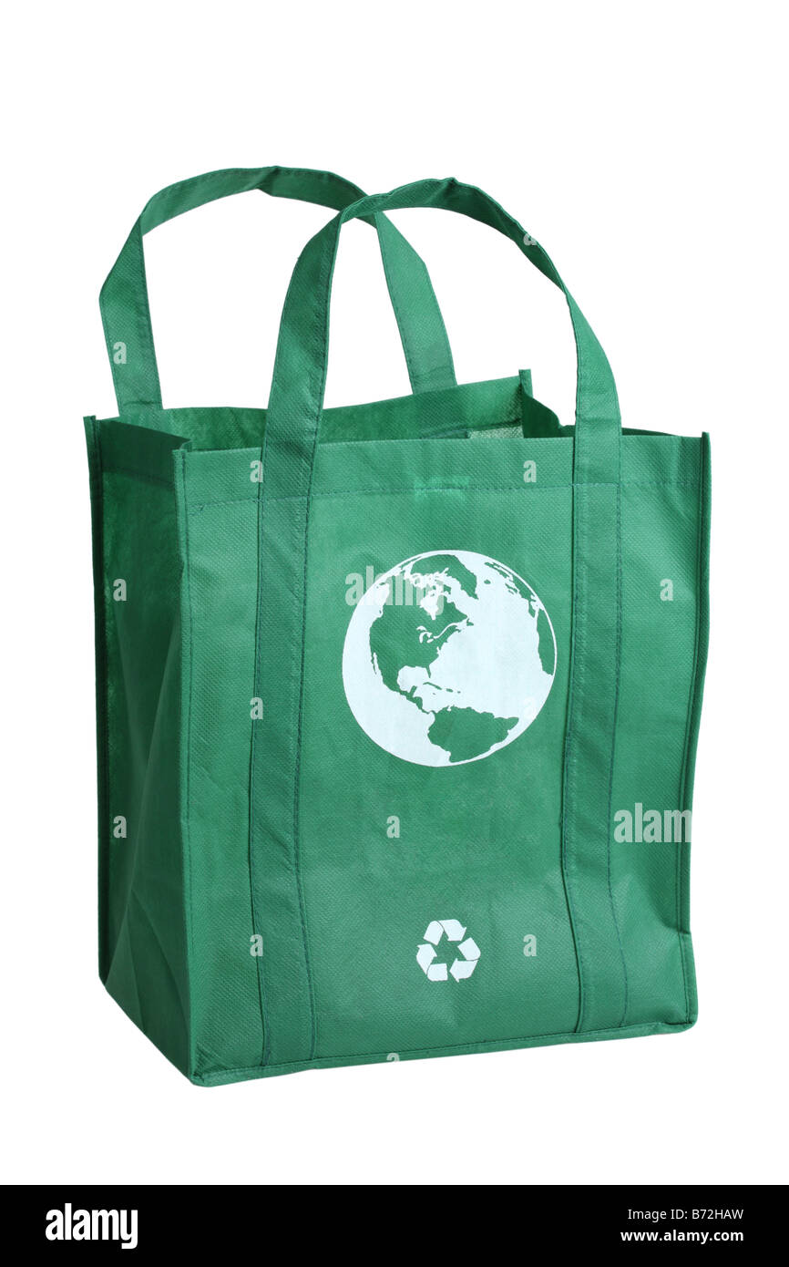 green reusable shopping bag cut out on white background stock photo