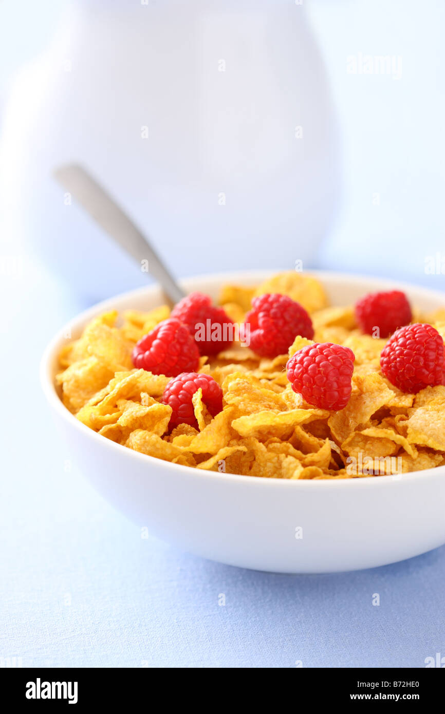Bowl of corn flakes with berries for breakfast - Stock Image