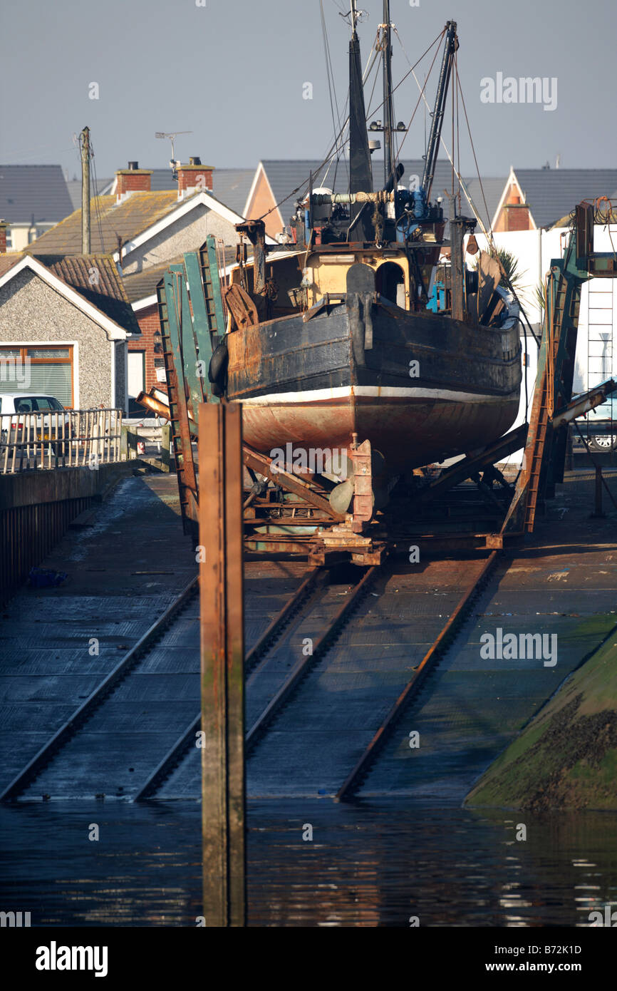 fishing boat in dry dock under repairs in portavogie county down Northern Ireland UK - Stock Image