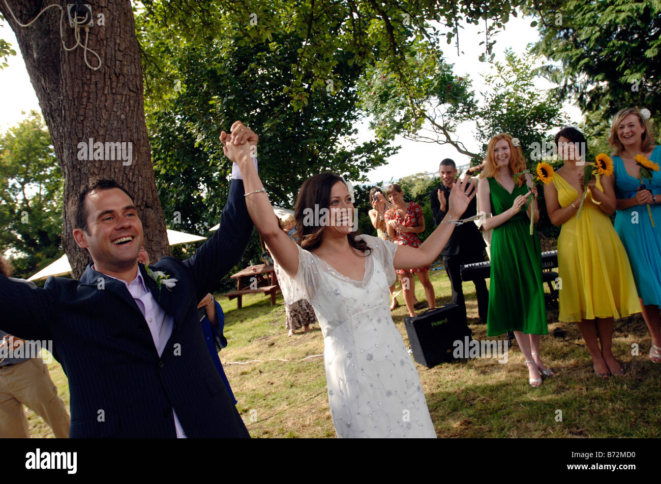 Civil wedding ceremony stock photos civil wedding ceremony stock a couple turn to the guests having completed a civil ceremony in garsington oxfordshire stock junglespirit Gallery