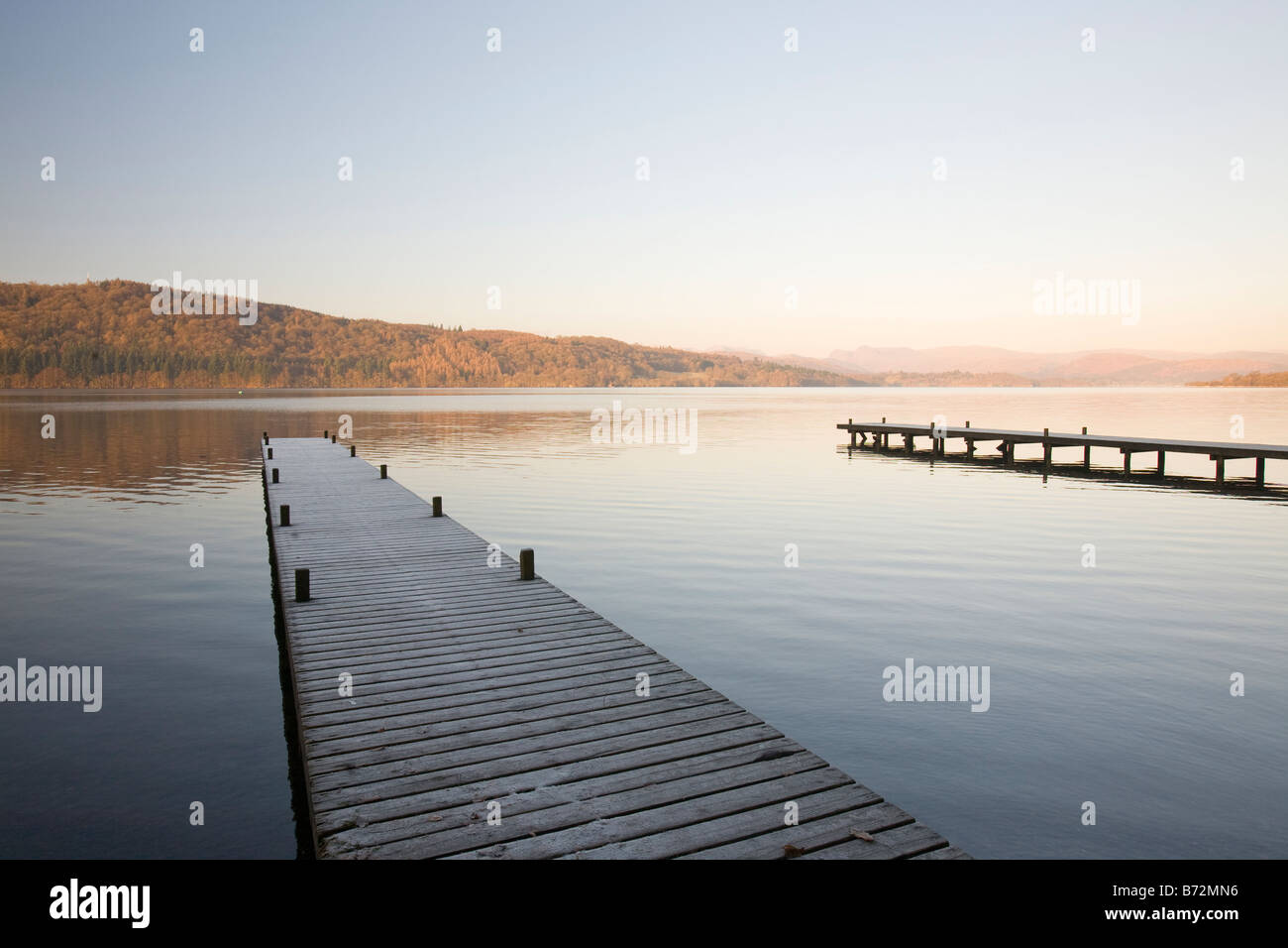 Frost on jetties on Lake Windermere in the Lake District UK - Stock Image