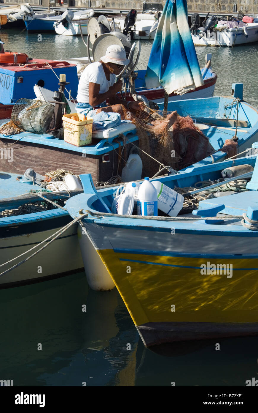 Fisher and fisherboats in Sant Angelo on the island Ischia Bay of Naples - Stock Image