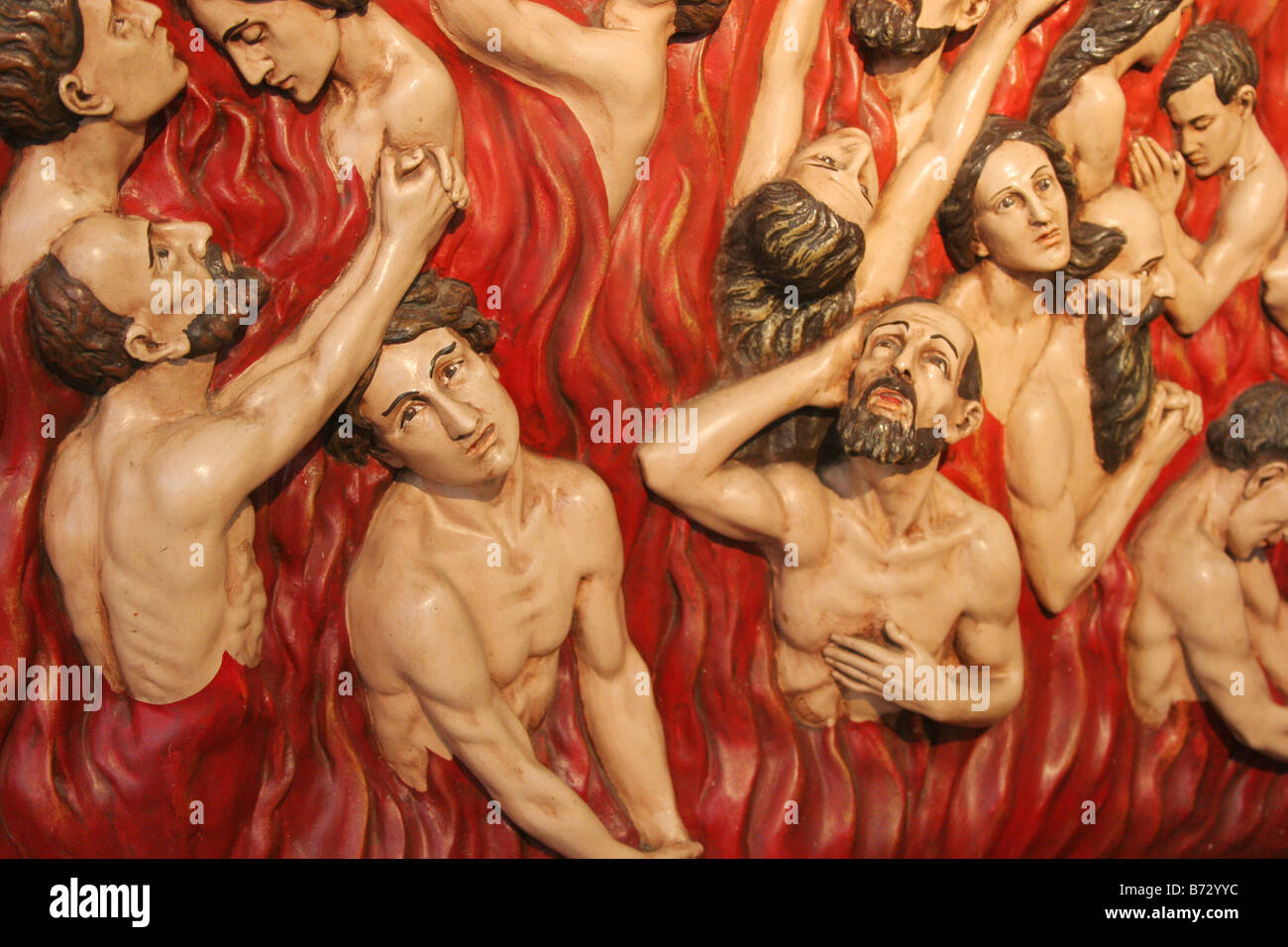 People burning in hell. - Stock Image