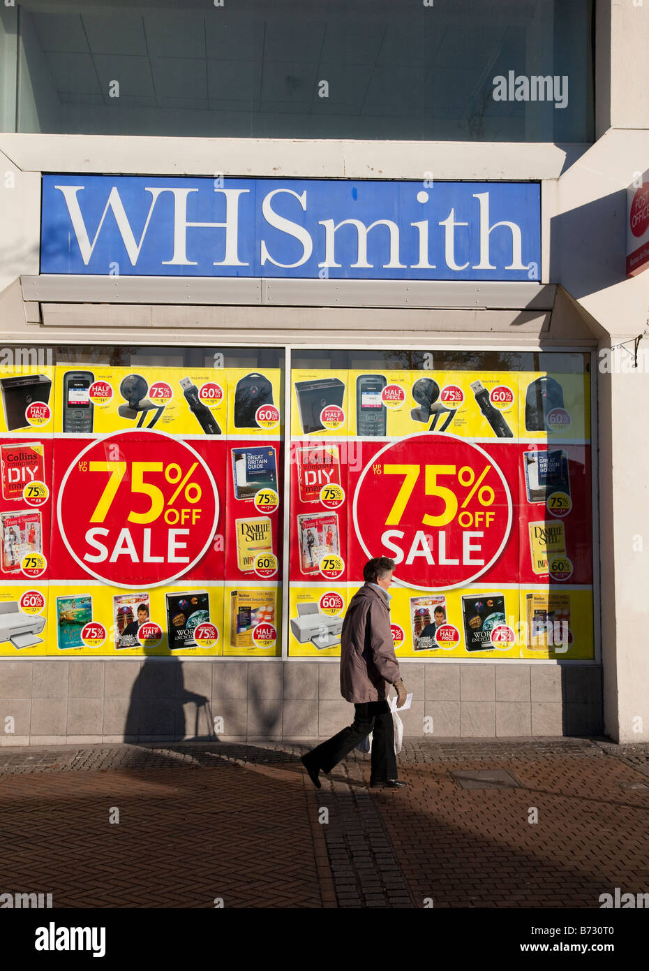 January sales 2009 banners offering 75 per cent off in window of WH Smith branch in Bournemouth - Stock Image