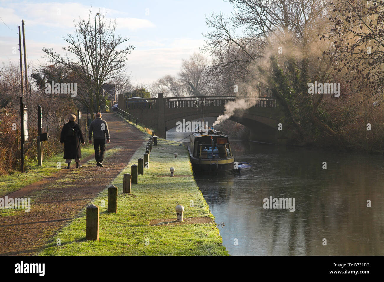 Winters morning walk alongside a canal. - Stock Image