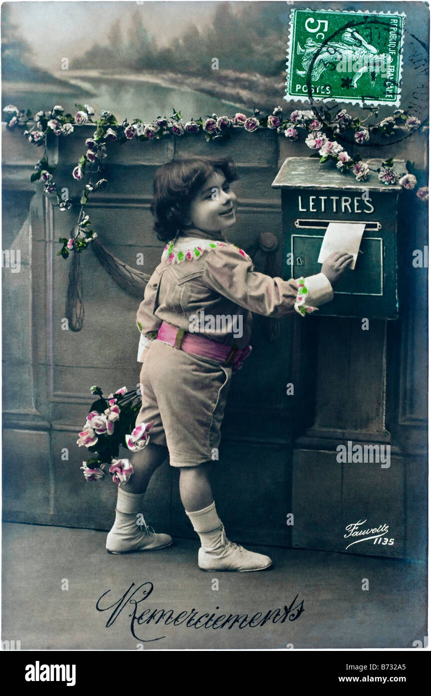 1912 French photo picture postcard with 'Remerciements' (Thank You) message, showing child posting letter, - Stock Image