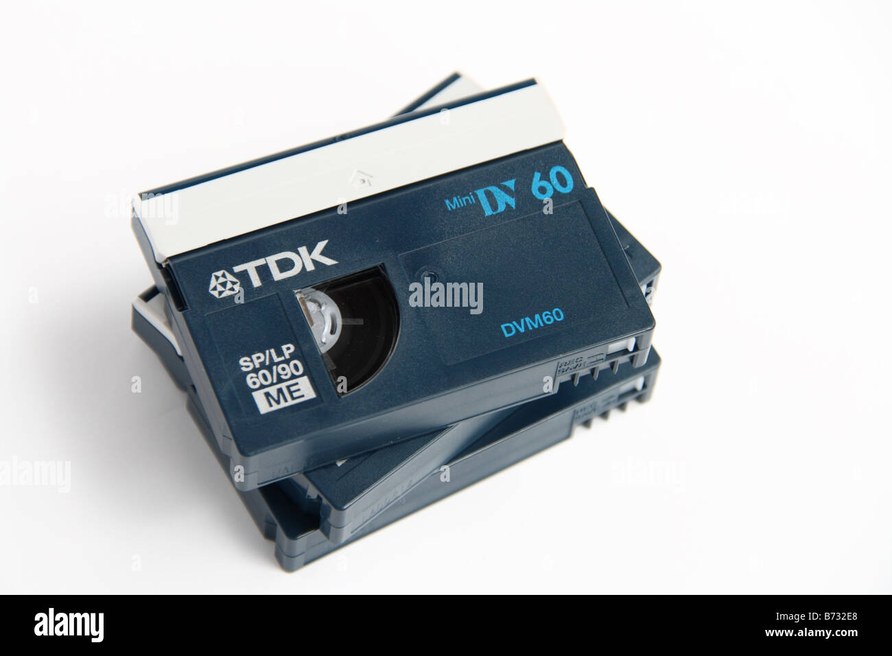 A pile of miniDV tapes isolated on white background - Stock Image