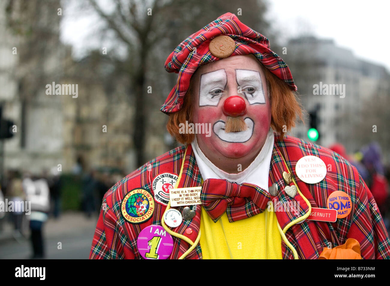 Colourful clown at the London Parade, a New Year's Day Parade in Central London - Stock Image