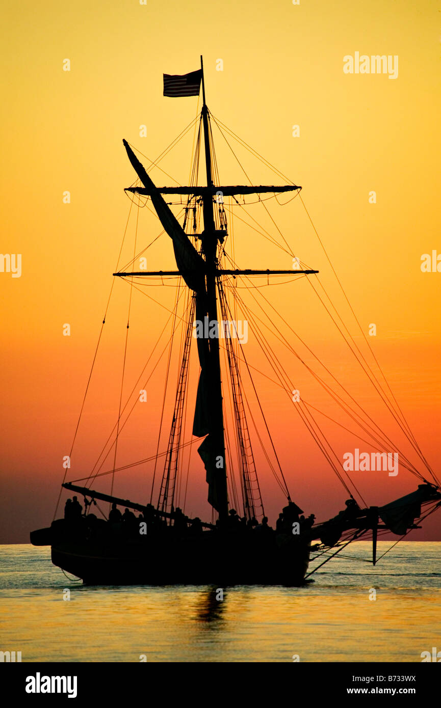 Friends Good Will a tall ship in a dramatic Lake Michigan sunset - Stock Image