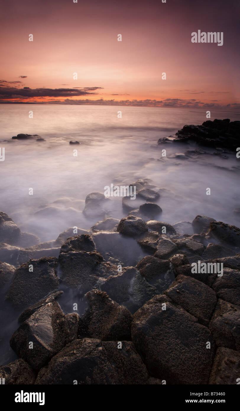 Sunset irish scene in Giant's Causeway, Northern Ireland - Stock Image