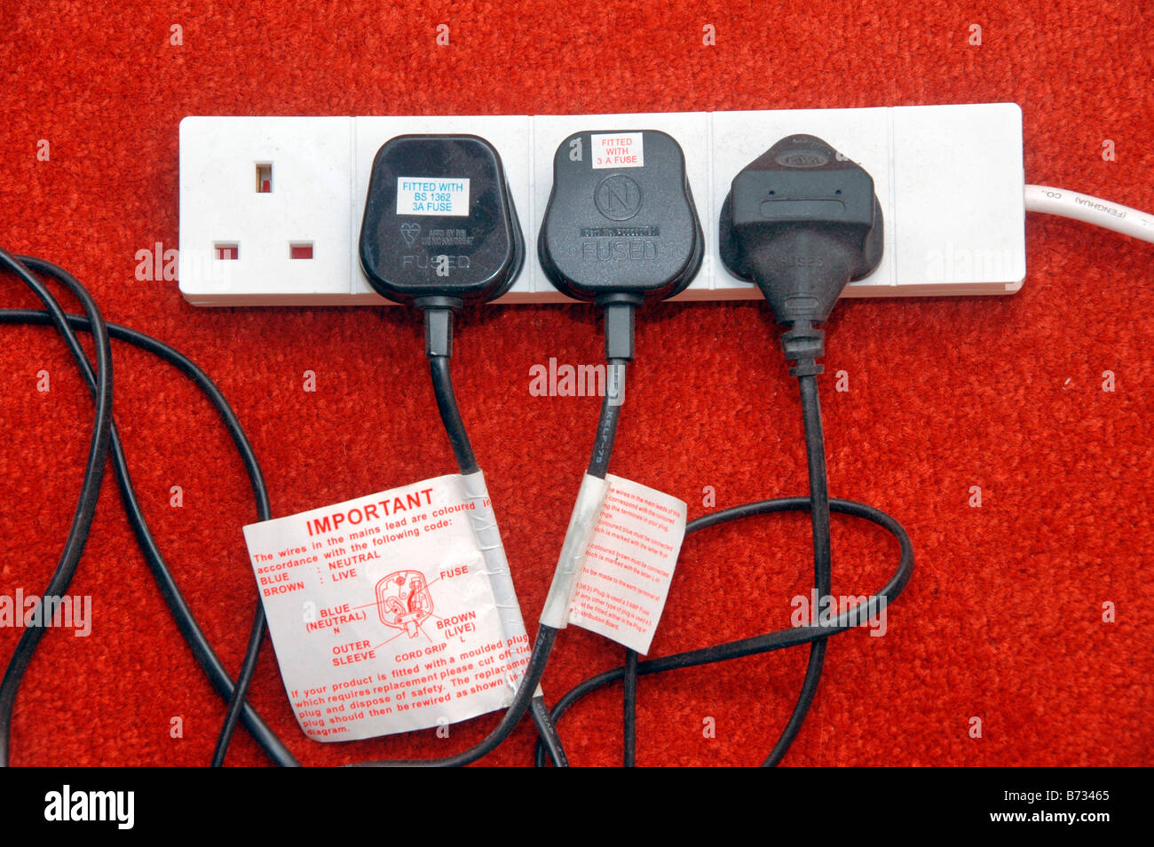 Electrical Wiring Plugs Stock Photos A Plug Replacing And Rewiring Electronics Four Extension Lead With Three Connected To It Image