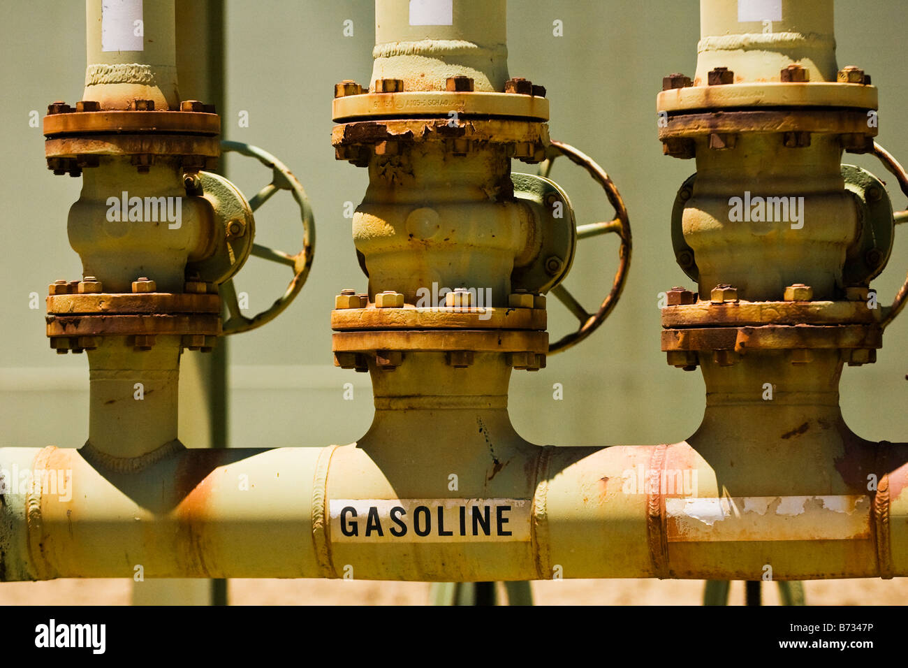 Gasoline faucet on a refinery pipeline. - Stock Image