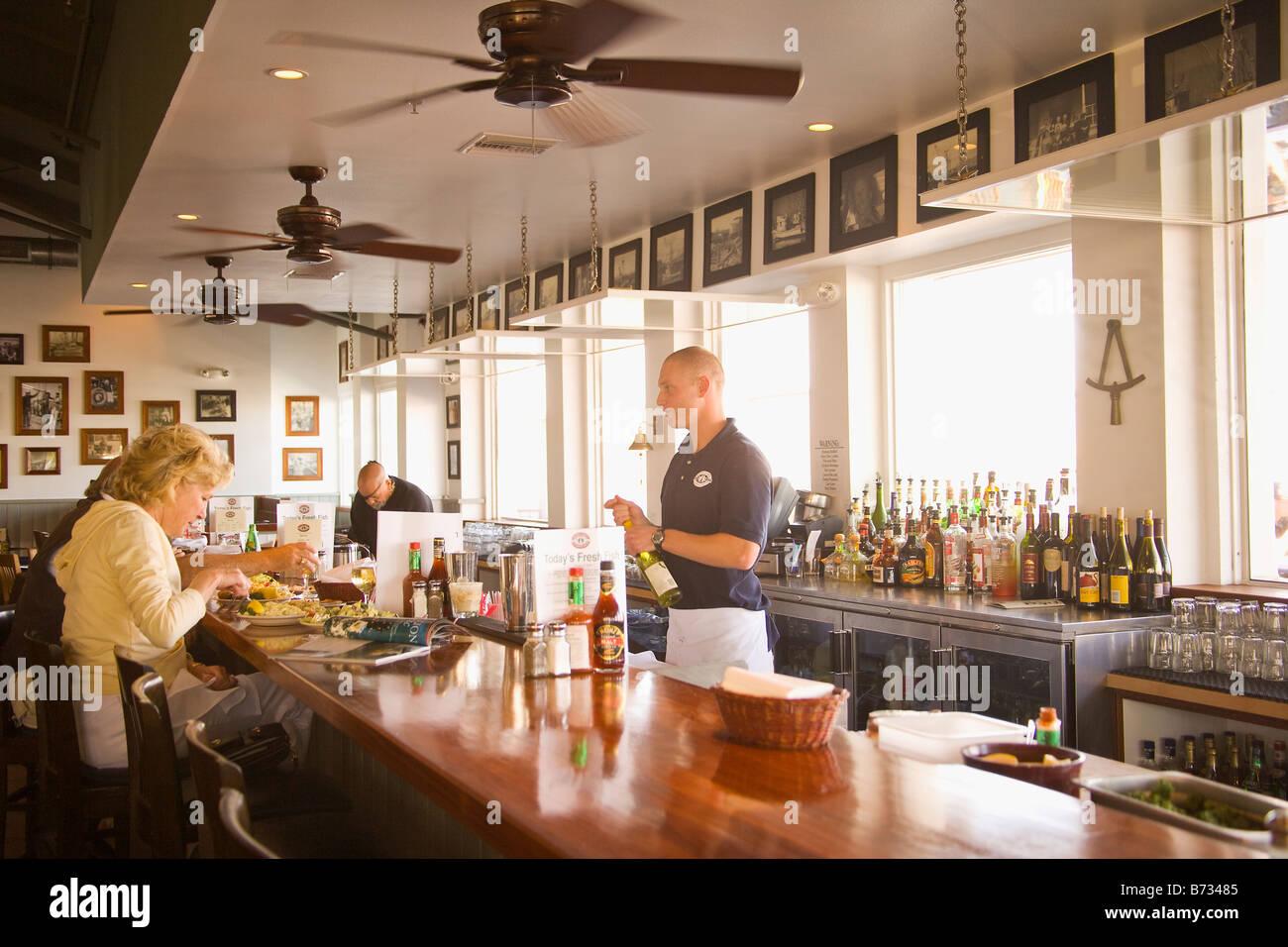 visitors dine at Brophy Bros Restaurant and Clam Bar Ventura Harbor Ventura California - Stock Image